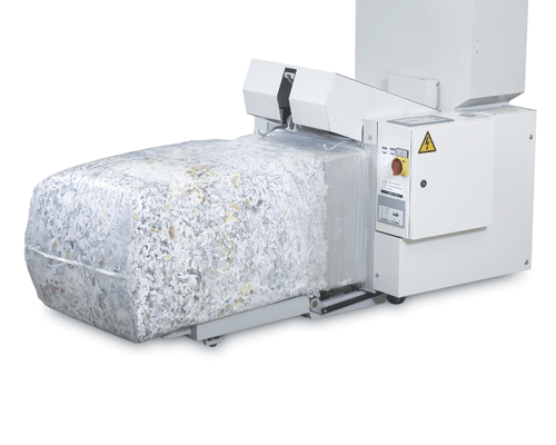 High-capacity Output Baler continually compacts shredded material into a bale, minimizing the frequency of unloading.